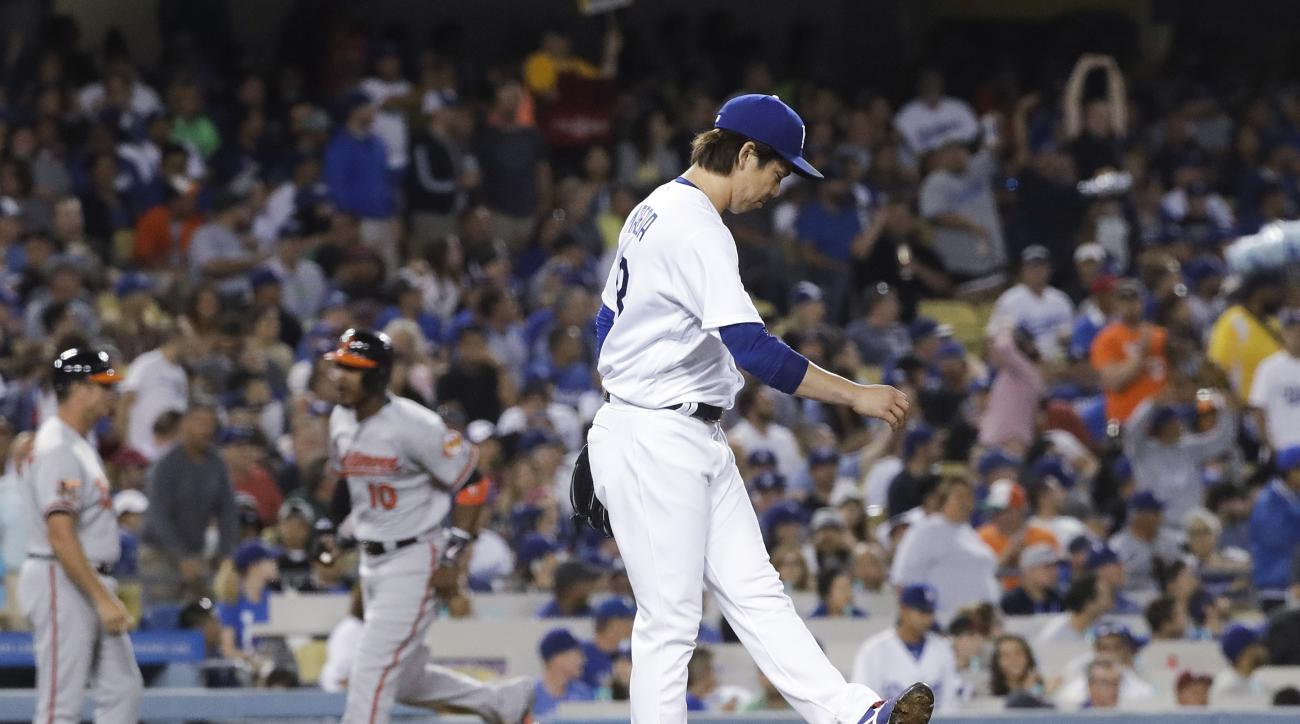 Los Angeles Dodgers starting pitcher Kenta Maeda reacts after giving up a three-run home run to Baltimore Orioles' Manny Machado during the fifth inning of a baseball game Tuesday, July 5, 2016, in Los Angeles. (AP Photo/Jae C. Hong)