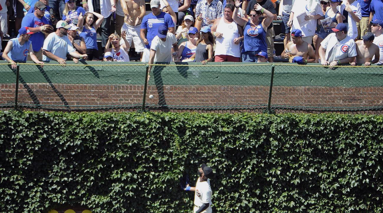 Chicago Cubs center fielder Jason Heyward (22) watches Cincinnati Reds' Tucker Barnhart three-run home run go into the bleachers during the seventh inning of a baseball game, Wednesday, July 6, 2016, in Chicago. (AP Photo/David Banks)