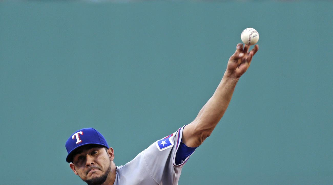 Texas Rangers starting pitcher Martin Perez throws during the first inning of a baseball game against the Boston Red Sox at Fenway Park, Wednesday, July 6, 2016, in Boston. (AP Photo/Charles Krupa)