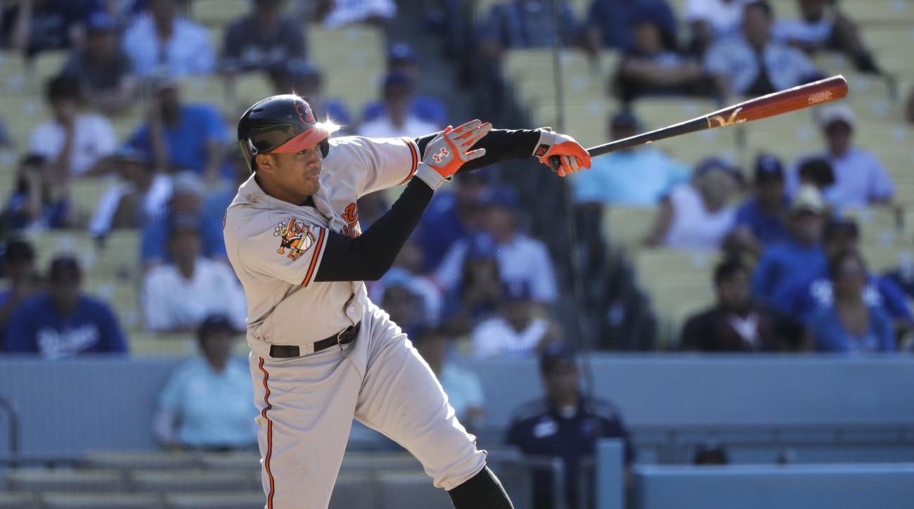 Baltimore Orioles' Jonathan Schoop hits a two-run double during the 14th inning of a baseball game against the Los Angeles Dodgers, Wednesday, July 6, 2016, in Los Angeles. (AP Photo/Jae C. Hong)