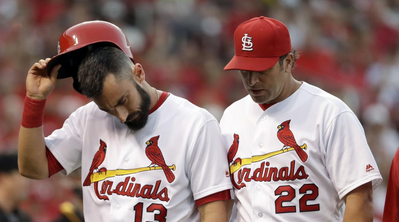 St. Louis Cardinals' Matt Carpenter, left, leaves the baseball game alongside manager Mike Matheny after being injured while batting during the third inning against the Pittsburgh Pirates on Wednesday, July 6, 2016, in St. Louis. (AP Photo/Jeff Roberson)