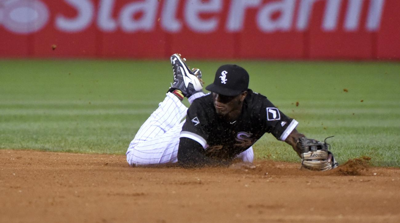 Chicago White Sox shortstop Tim Anderson catches a line drive by New York Yankees' Mark Teixeira during the fourth inning of a baseball game in Chicago on Wednesday, July 6, 2016. (AP Photo/Matt Marton)