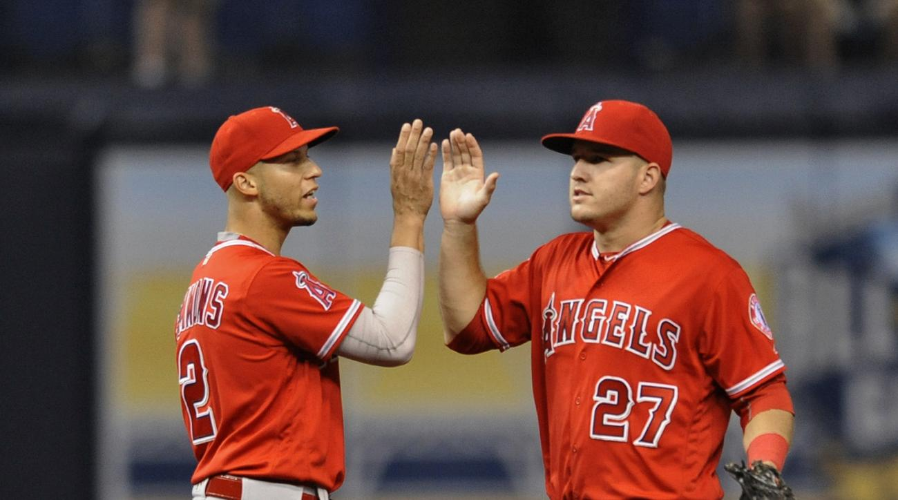 Los Angeles Angels' Andrelton Simmons, left, and Mike Trout, right, celebrate a 7-2 win over the Tampa Bay Rays in a baseball game Wednesday, July 6, 2016, in St. Petersburg, Fla. (AP Photo/Steve Nesius)