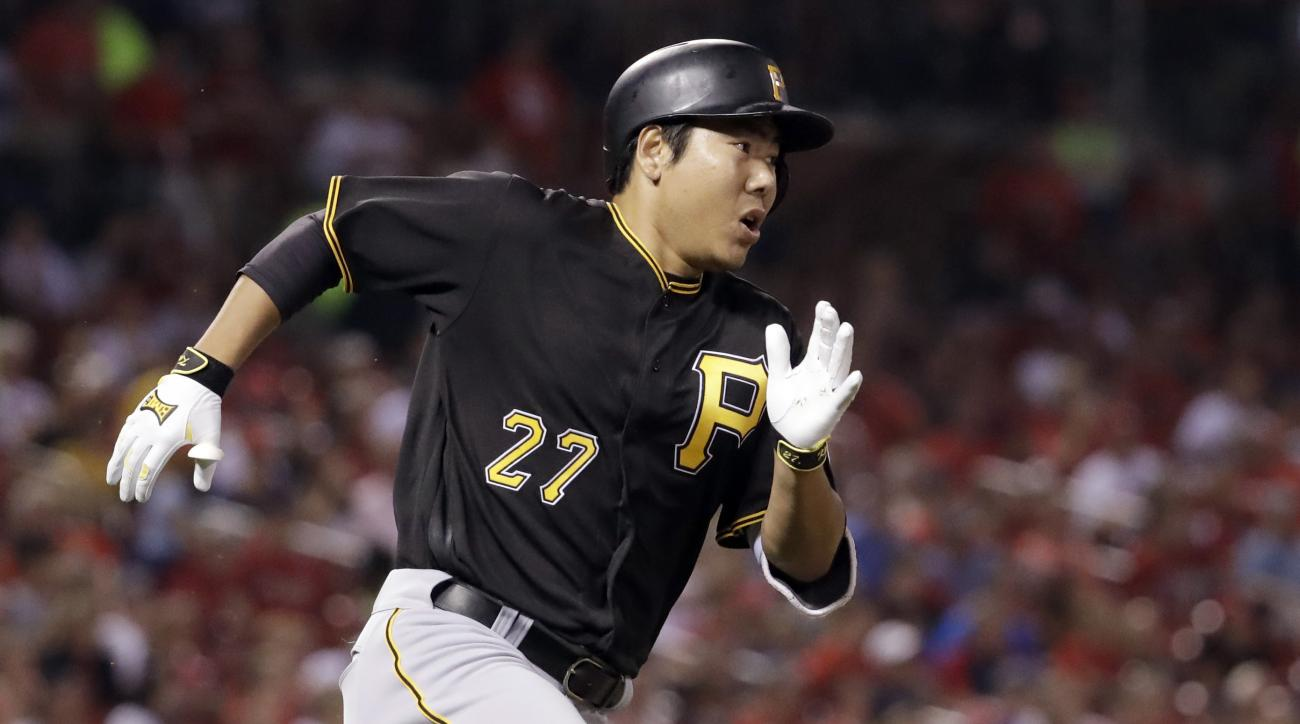 Pittsburgh Pirates' Jung Ho Kang rounds first after hitting a two-run double off St. Louis Cardinals relief pitcher Jonathan Broxton during the seventh inning of a baseball game Wednesday, July 6, 2016, in St. Louis. (AP Photo/Jeff Roberson)