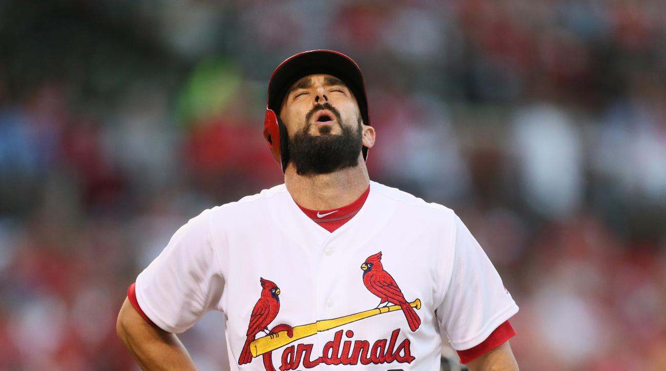 St. Louis Cardinals' Matt Carpenter grips his side after swinging at a pitch in the third inning of a baseball game against the Pittsburgh Pirates on Wednesday, July 6, 2016, in St. Louis. (Chris Lee/St. Louis Post-Dispatch via AP)