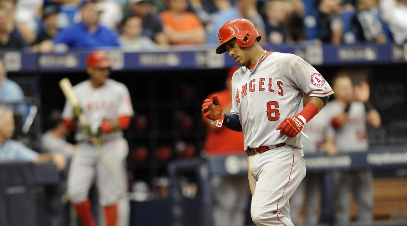 Los Angeles Angels' Yunel Escobar  scores on Albert Pujols' single off Tampa Bay Rays pitcher Blake Snell during the sixth inning of a baseball game Thursday, July 7, 2016, in St. Petersburg, Fla. (AP Photo/Steve Nesius)