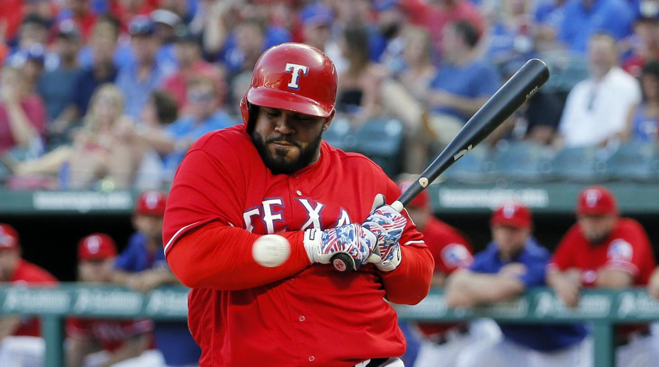 Texas Rangers' Prince Fielder is hit by a pitch from Minnesota Twins' Tyler Duffey in the first inning of a baseball game, Thursday, July 7, 2016, in Arlington, Texas. (AP Photo/Tony Gutierrez)