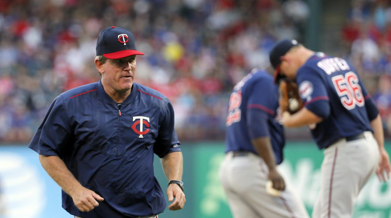 Minnesota Twins pitching coach Neil Allen jogs back to the dugout after paying starting pitcher Tyler Duffey a visit on the mound in the first inning of a baseball game against the Texas Rangers on Thursday, July 7, 2016, in Arlington, Texas. (AP Photo/To