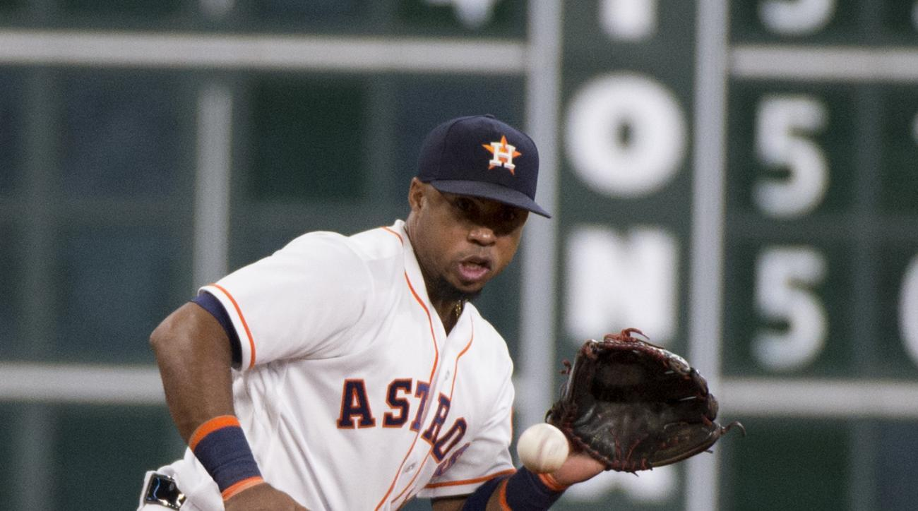 Houston Astros third baseman Luis Valbuena (18) fields a ball hit by the Oakland Athletics Khris Davis in the fourth inning of a baseball game Thursday, July 7, 2016, in Houston. (AP Photo/George Bridges)