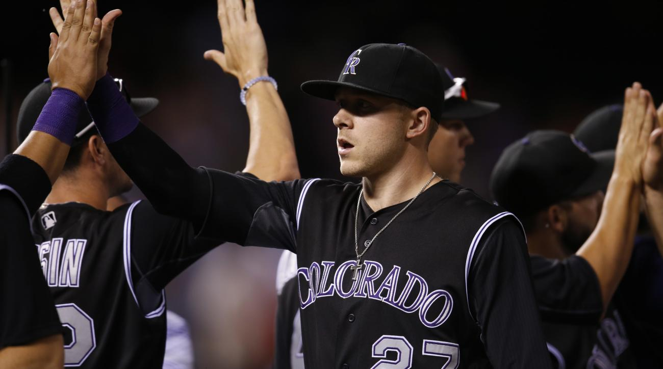 FILE - In this July 7, 2016, file photo, Colorado Rockies shortstop Trevor Story is congratulated by teammates after helping to retire the Philadelphia Phillies in the ninth inning of a baseball game, in Denver. Rookie Trevor Story and fellow rookies Mich