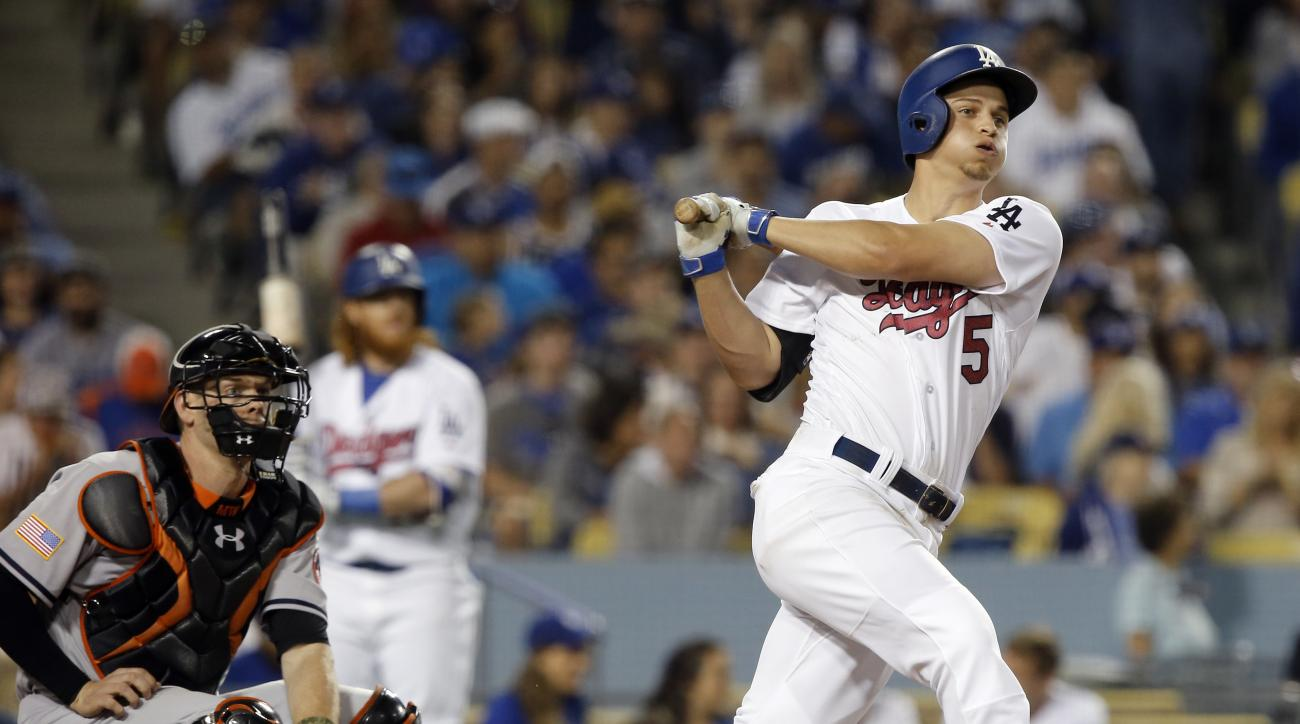 FILE - In this July 4, 2016, file photo, Los Angeles Dodgers' Corey Seager, right, hits a triple with Baltimore Orioles catcher Matt Wieters, left, watching during the seventh inning of a baseball game in Los Angeles. Rookie Corey Seagar and fellow rookie