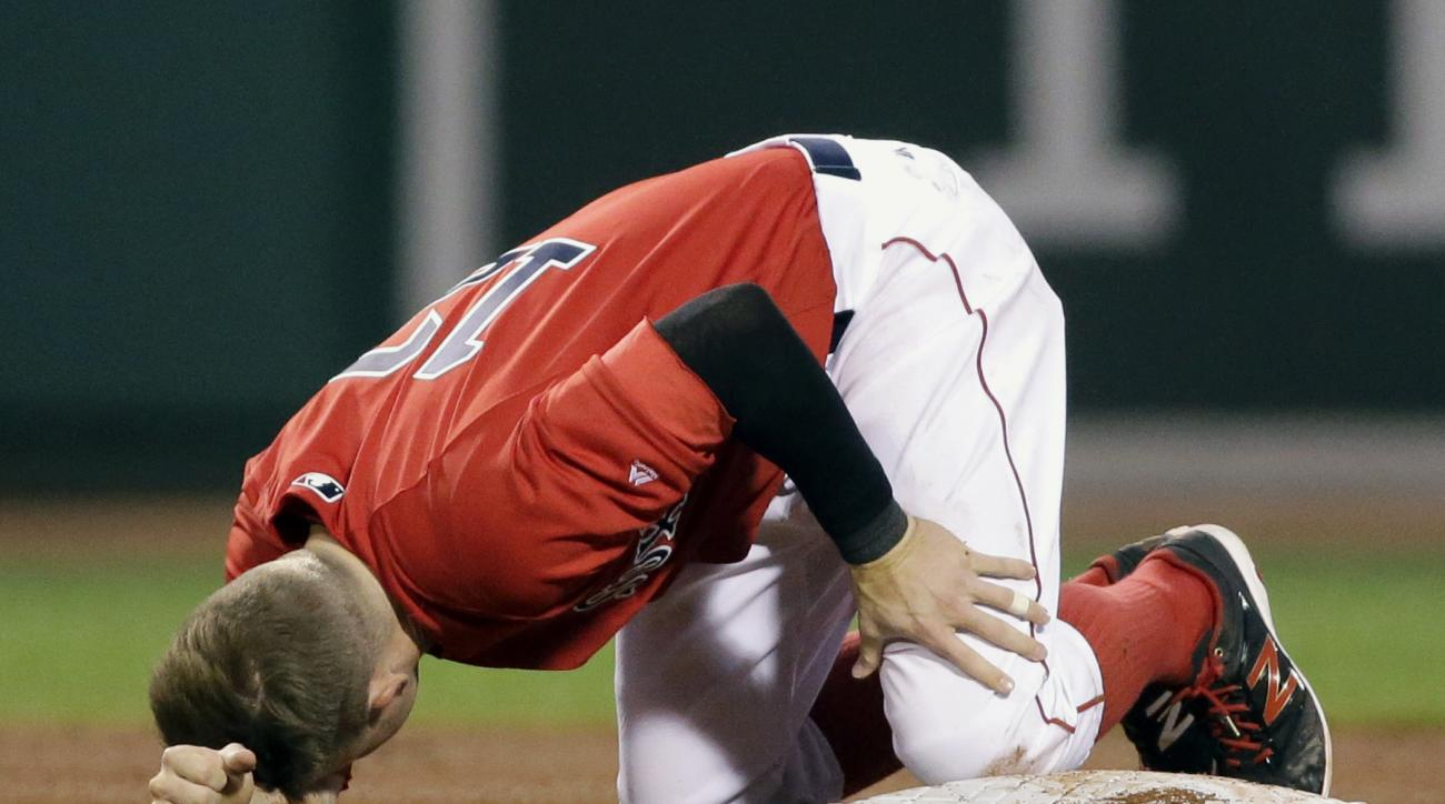 Boston Red Sox's Brock Holt holds his left leg after stealing second base in the fourth inning of a baseball game against the Tampa Bay Rays at Fenway Park, Friday, July 8, 2016, in Boston. Holt left the game with an injury. (AP Photo/Elise Amendola)