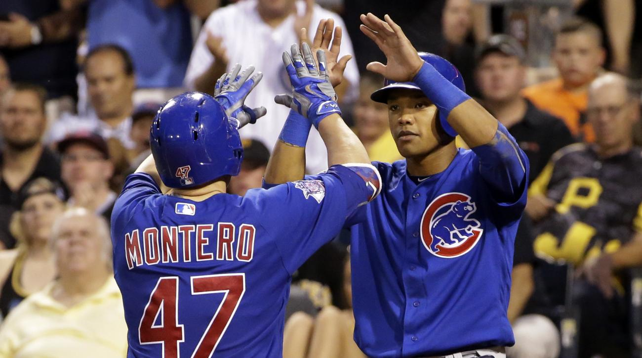 Chicago Cubs' Miguel Montero (47) celebrates with teammate Addison Russell after hitting a two-run home run off Pittsburgh Pirates relief pitcher Juan Nicasio in the sixth inning of a baseball game in Pittsburgh, Friday, July 8, 2016. (AP Photo/Gene J. Pu
