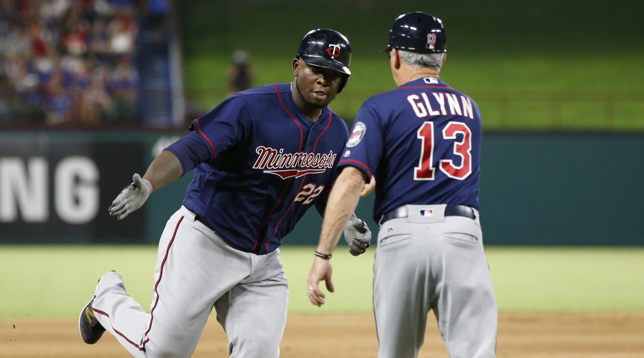 Minnesota Twins' Miguel Sano (22) celebrates his three-run home run with third base coach Gene Glynn (13) against the Texas Rangers during the fifth inning of a baseball game, Friday, July 8, 2016, in Arlington, Texas. (AP Photo/Jim Cowsert)