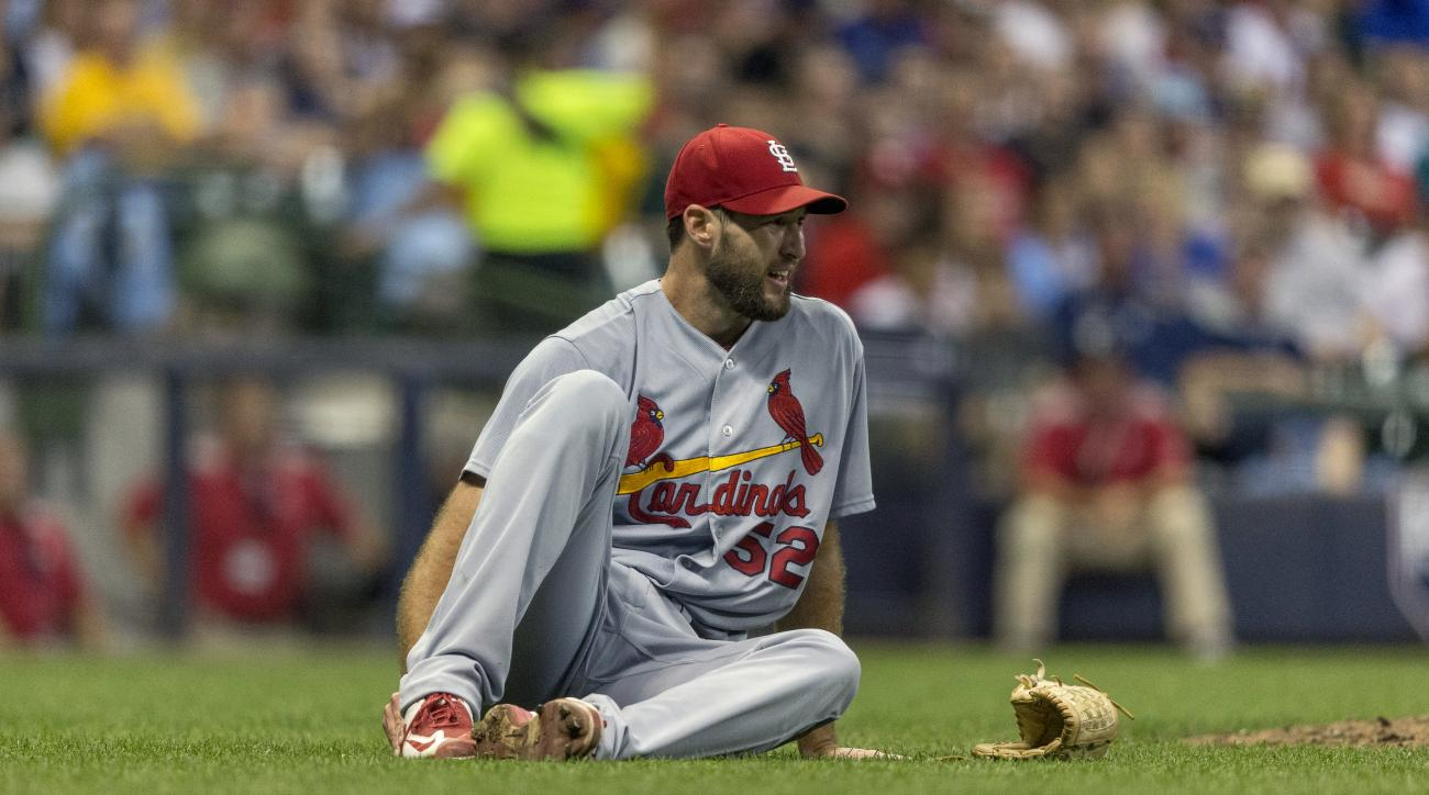 St. Louis Cardinals' Michael Wacha drops to the field after being hit in the foot during the seventh inning of a baseball game against the Milwaukee Brewers, Friday, July 8, 2016, in Milwaukee. (AP Photo/Tom Lynn)