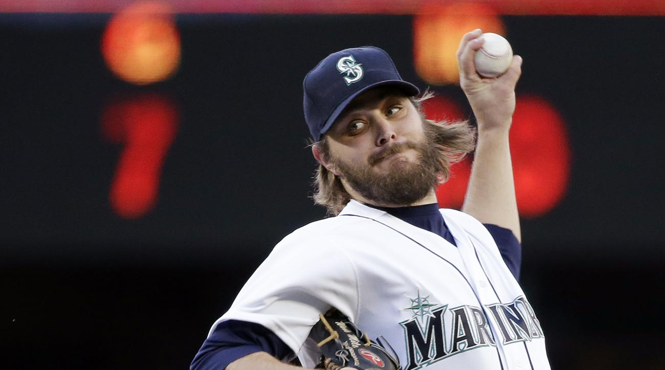 FILE - In this May 10, 2016, file photo, Seattle Mariners starting pitcher Wade Miley throws against the Tampa Bay Rays during the first inning of a baseball game in Seattle. Miley hears the talk about lifting the bottom of the strike zone in an effort to