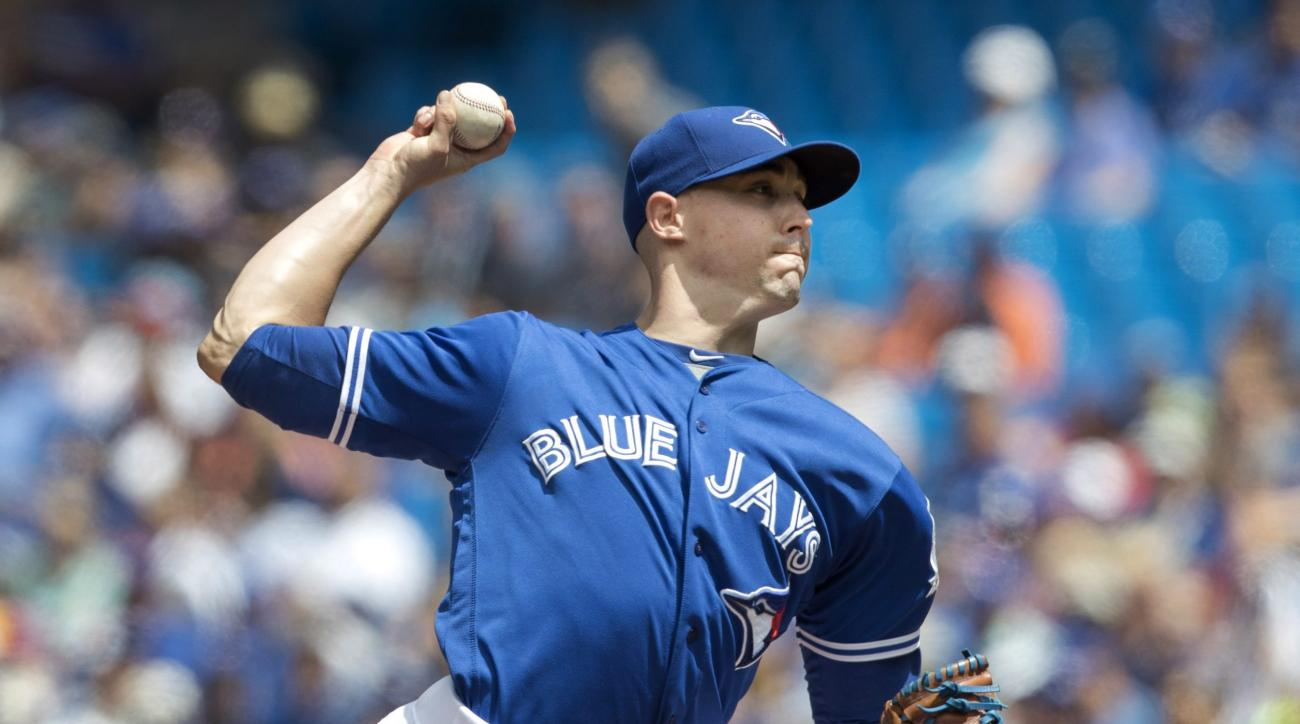 Toronto Blue Jays starting pitcher Aaron Sanchez throws against the Detroit Tigers during the first inning of a baseball game in Toronto, Saturday, July 9, 2016. (Fred Thornhill/The Canadian Press via AP)