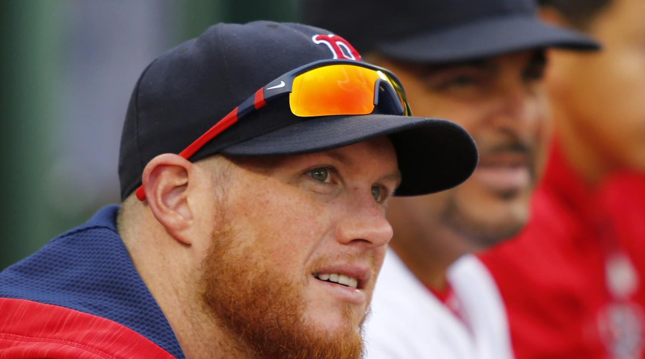Boston Red Sox relief pitcher Craig Kimbrel looks on from the dugout during the eighth inning of a baseball game against the Tampa Bay Rays at Fenway Park in Boston, Saturday, July 9, 2016. Kimberly injured his knee and will be out for weeks. (AP Photo/Wi