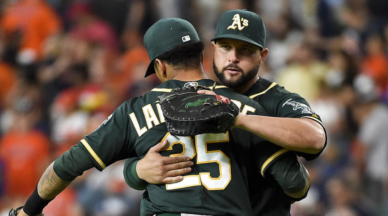 Oakland Athletics' Yonder Alonso, right, and Tyler Ladendorf celebrate their 3-2 victory over the Houston Astros in a baseball game, Saturday, July 9, 2016, in Houston. (AP Photo/Eric Christian Smith)