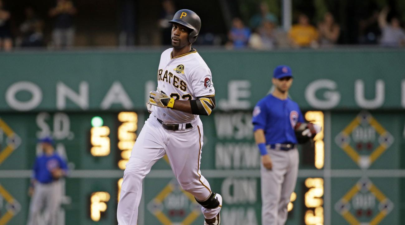 Pittsburgh Pirates' Andrew McCutchen rounds second after hitting a solo home run off Chicago Cubs starting pitcher Jon Lester in the third inning of a baseball game in Pittsburgh, Saturday, July 9, 2016. (AP Photo/Gene J. Puskar)