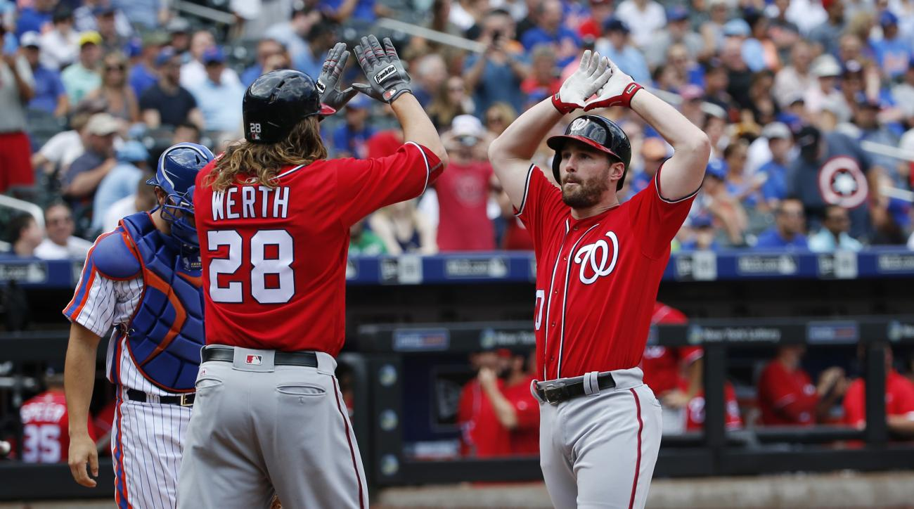 Washington Nationals Jayson Werth (28) greets Washington Nationals Daniel Murphy at the plate after scoring on Murphy's, first-inning, two-run, home run in a baseball game against the New York Mets, Sunday, July 10, 2016, in New York. (AP Photo/Kathy Will