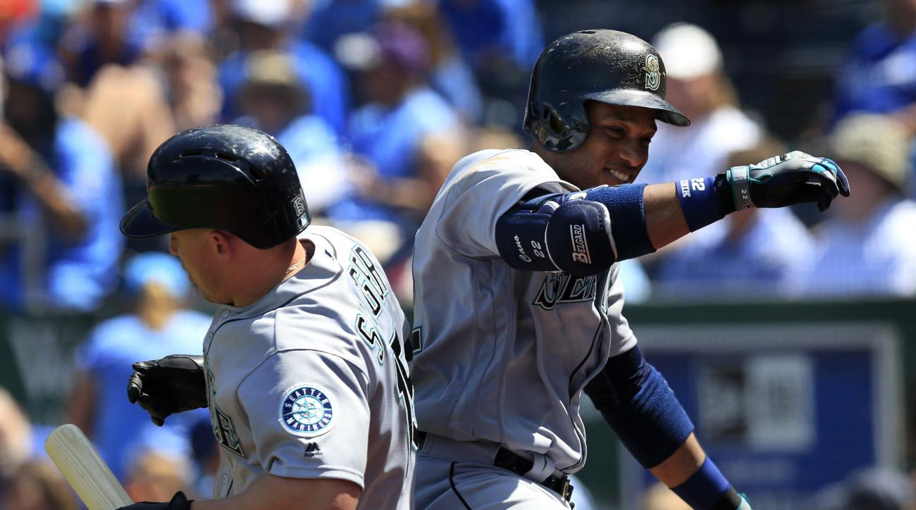 Seattle Mariners' Robinson Cano, right, celebrates with teammate Kyle Seager (15) following his two-run home run during the seventh inning of a baseball game against the Kansas City Royals at Kauffman Stadium in Kansas City, Mo., Sunday, July 10, 2016. (A