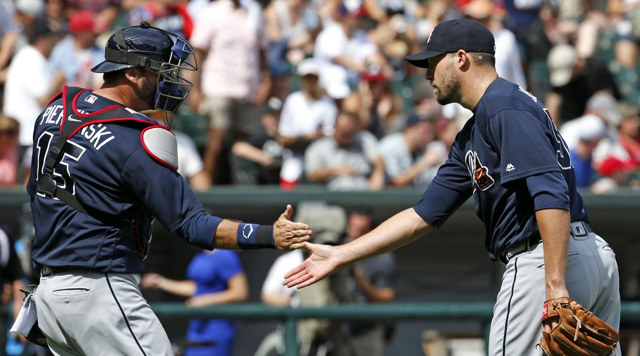 Atlanta Braves closer Jim Johnson, right, celebrates with catcher A.J. Pierzynski after they defeated the Chicago White Sox in an interleague baseball game in Chicago, Sunday, July 10, 2016. (AP Photo/Nam Y. Huh)
