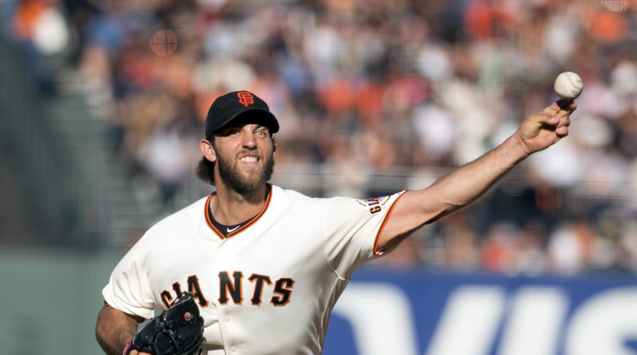 San Francisco Giants starting pitcher Madison Bumgarner delivers against the Arizona Diamondbacks during the third inning of a baseball game on Sunday, July 10, 2016, in San Francisco. (AP Photo/D. Ross Cameron)