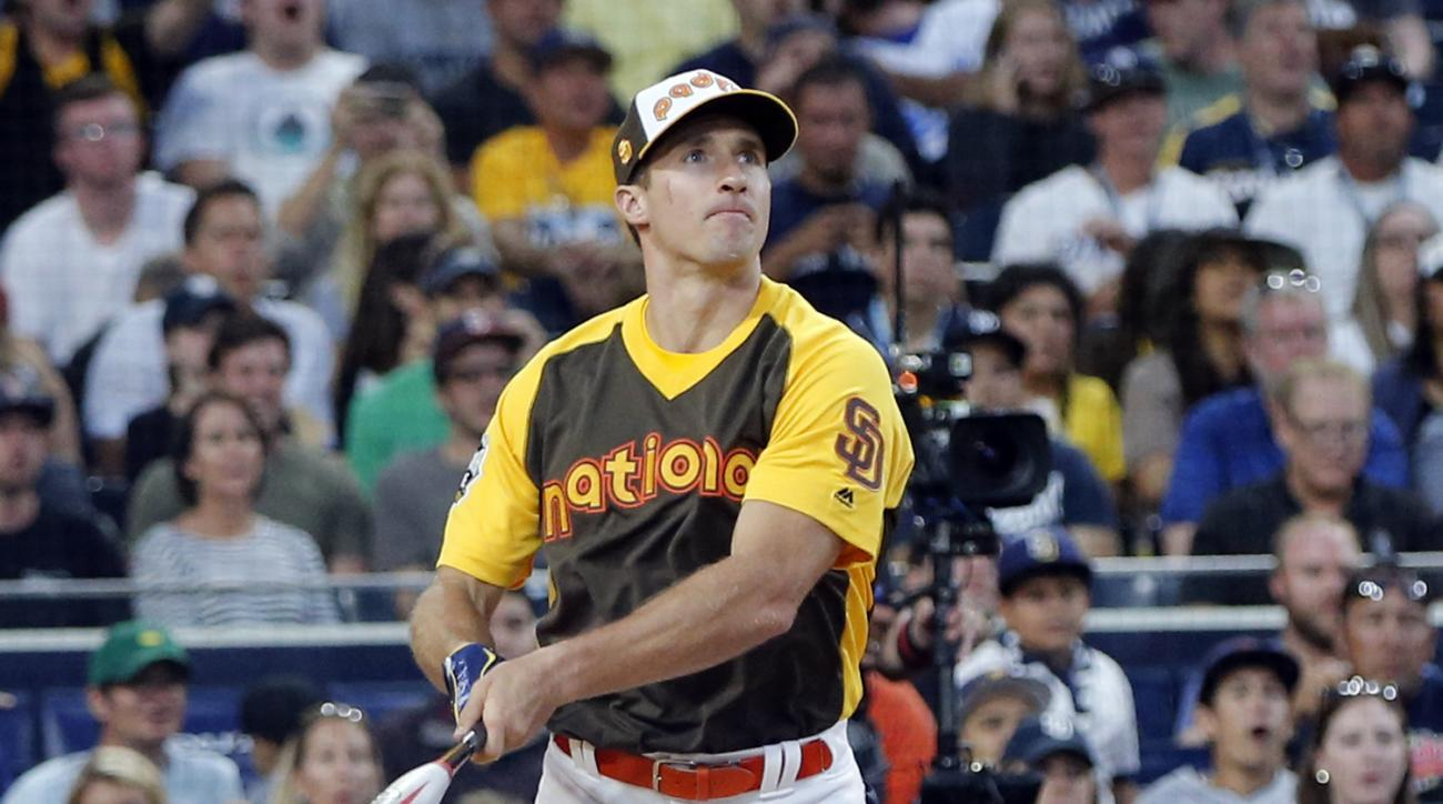 New Orleans Saints quarterback Drew Brees hits a home run during the All-Star Legends & Celebrity Softball game, Sunday, July 10, 2016, in San Diego. (AP Photo/Lenny Ignelzi)