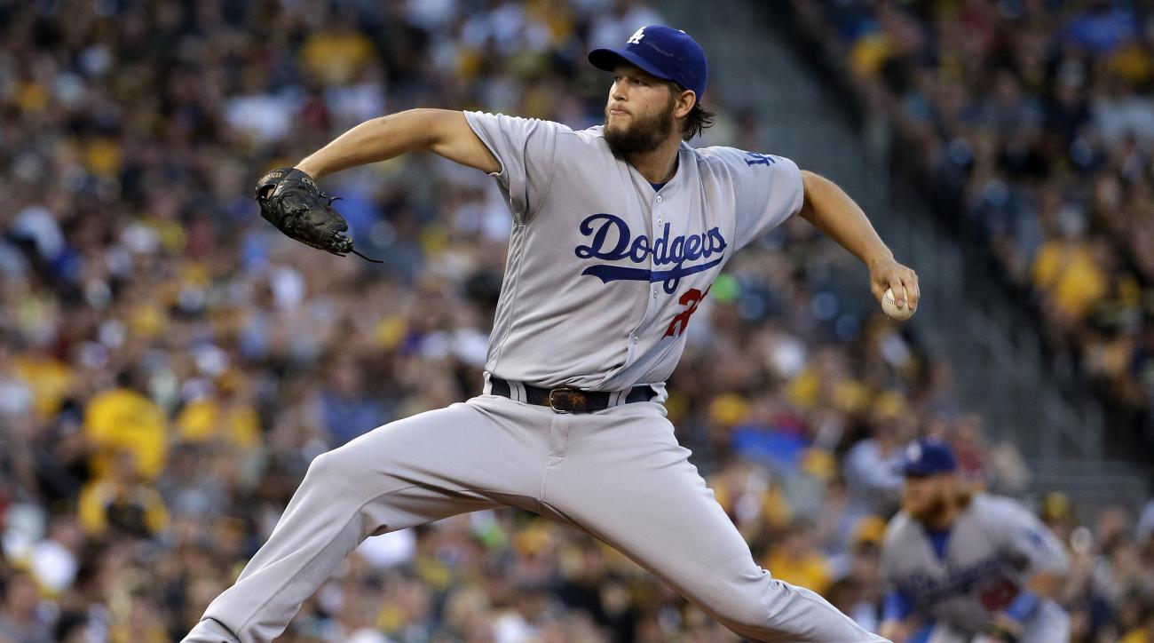 FILE - In this June 26, 2016, file photo, Los Angeles Dodgers starting pitcher Clayton Kershaw delivers in the first inning of a baseball game against the Pittsburgh Pirates in Pittsburgh. In 2014, Kershaw became the first pitcher to win the National Leag