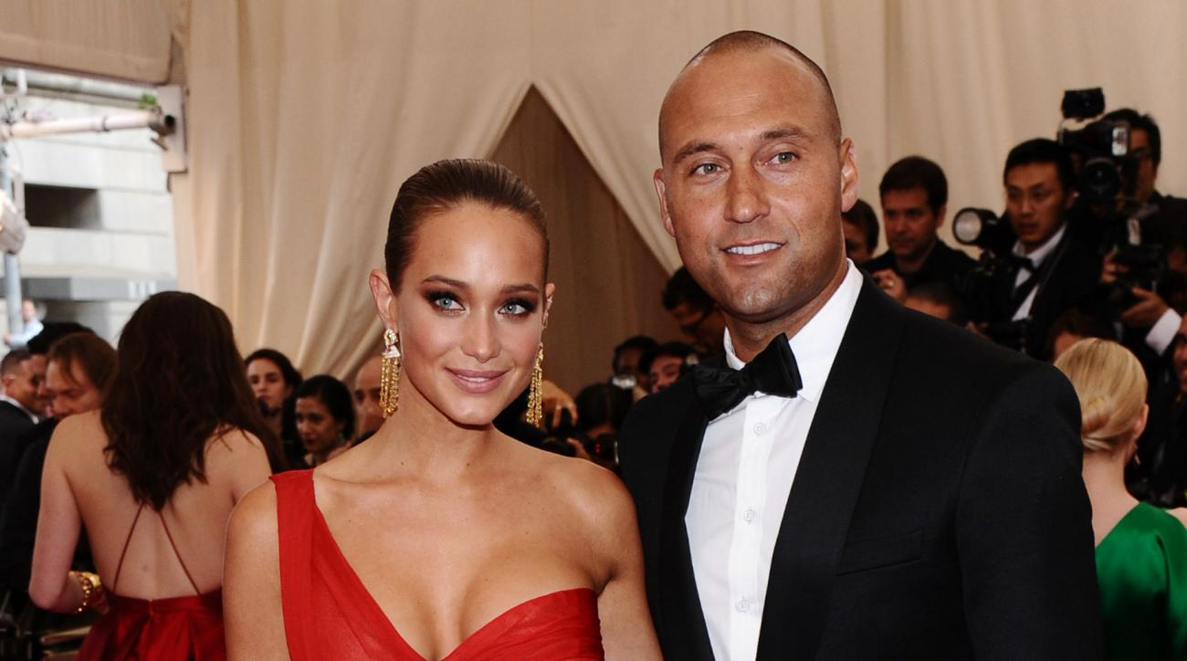 """FILE - In this May 4, 2015, file photo, Derek Jeter, right, and Hannah Davis arrive at The Metropolitan Museum of Art's Costume Institute benefit gala celebrating """"China: Through the Looking Glass"""" in New York. Derek Jeter has reportedly married his longt"""
