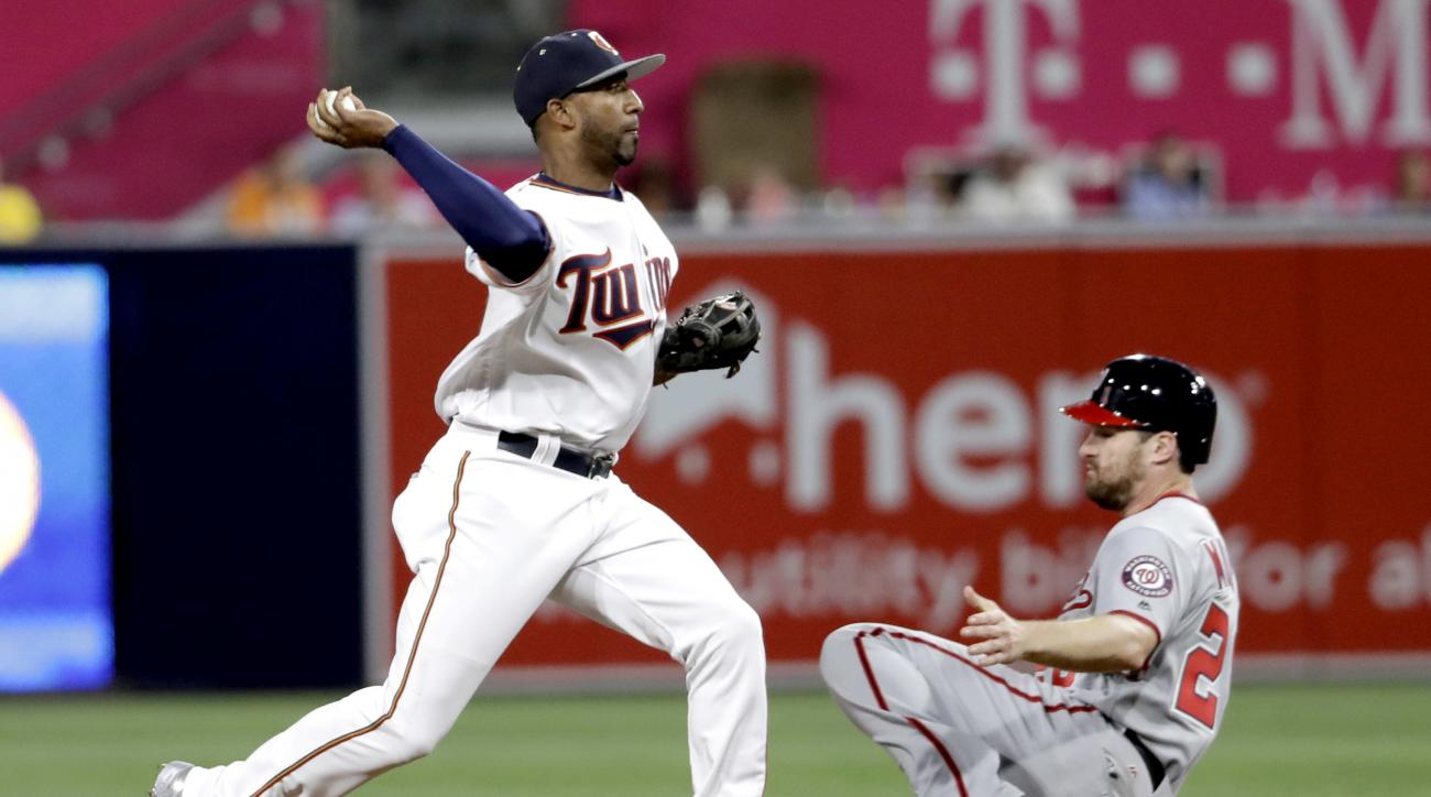American League's Eduardo Nunez, of the Minnesota Twins, forces out National League's Daniel Murphy, of the Washington Nationals, but is unable to turn a double play on National League's Paul Goldschmidt, of the Arizona Diamondbacks, during the ninth the