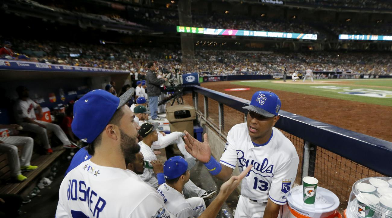 American League's Salvador Perez, of the Kansas City Royals, congratulates teammate Eric Hosmer, of the Kansas City Royals, for Hosmer's MVP award in the MLB baseball All-Star Game, Tuesday, July 12, 2016, in San Diego. The American League won 4-2. (AP Ph