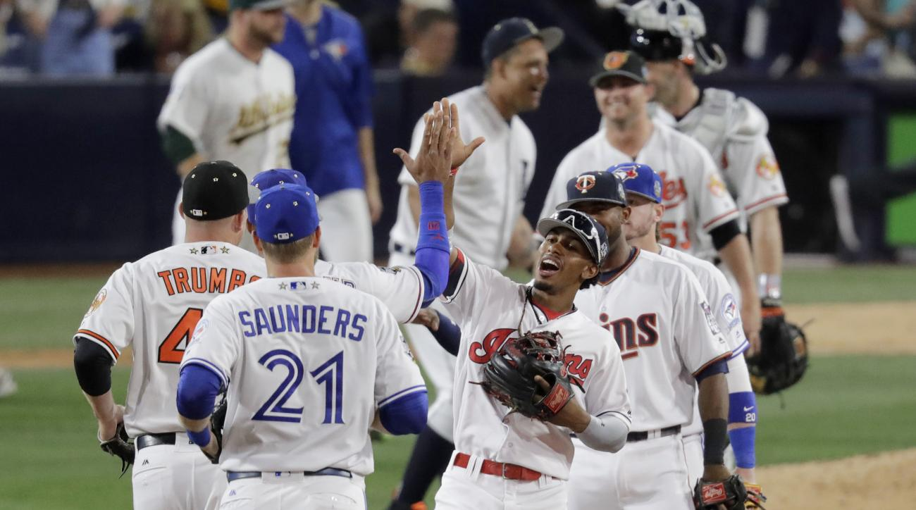 American League players celebrate after the MLB baseball All-Star Game, Tuesday, July 12, 2016, in San Diego. The American League defeated the National League 4-2. (AP Photo/Jae C. Hong)