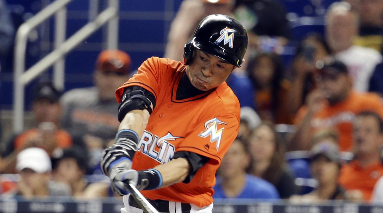 FILE - In this June 5, 2016, file photo, Miami Marlins' Ichiro Suzuki hits a single during the eighth inning of a baseball game against the New York Mets in Miami. The 42-year-old Miami player is chasing 3,000 hits in the majors. (AP Photo/Lynne Sladky, F
