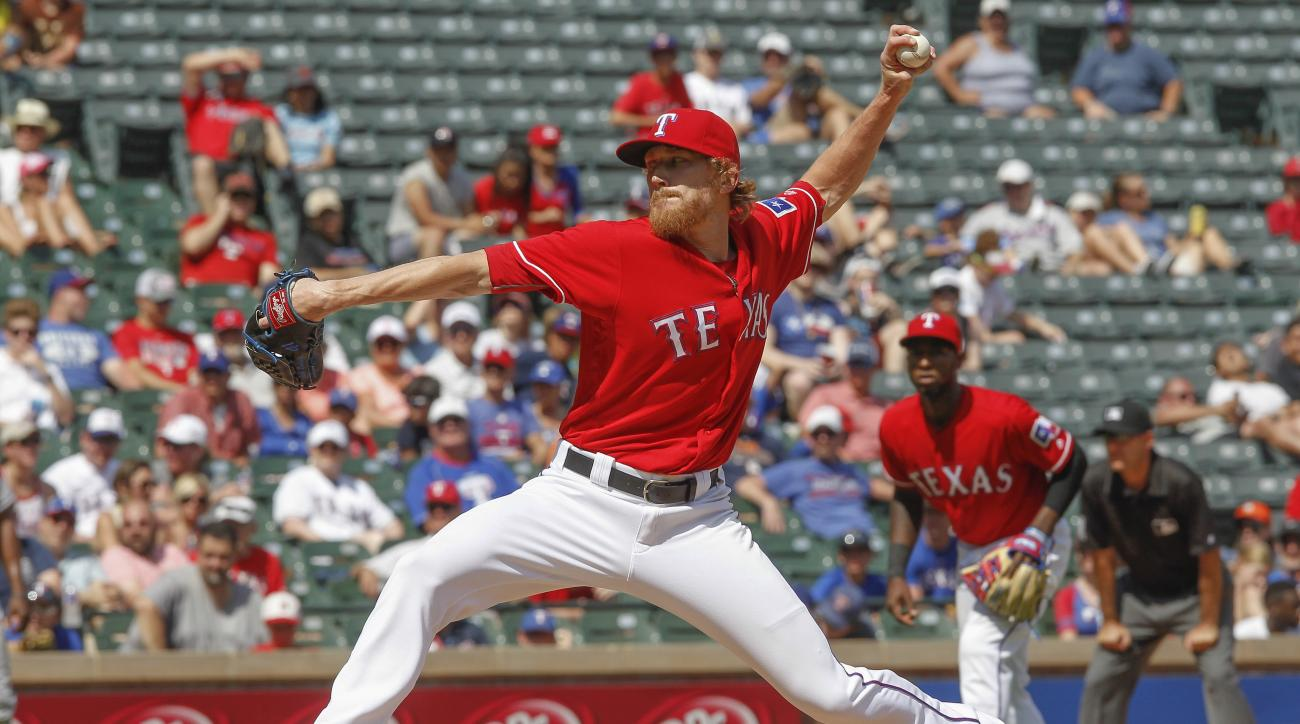 Texas Rangers pitcher Jake Diekman throws against the Houston Astros in the ninth inning of a baseball game Thursday, June 9, 2016, in Arlington, Texas.  Texas won 5-3. (AP Photo/Tim Sharp)