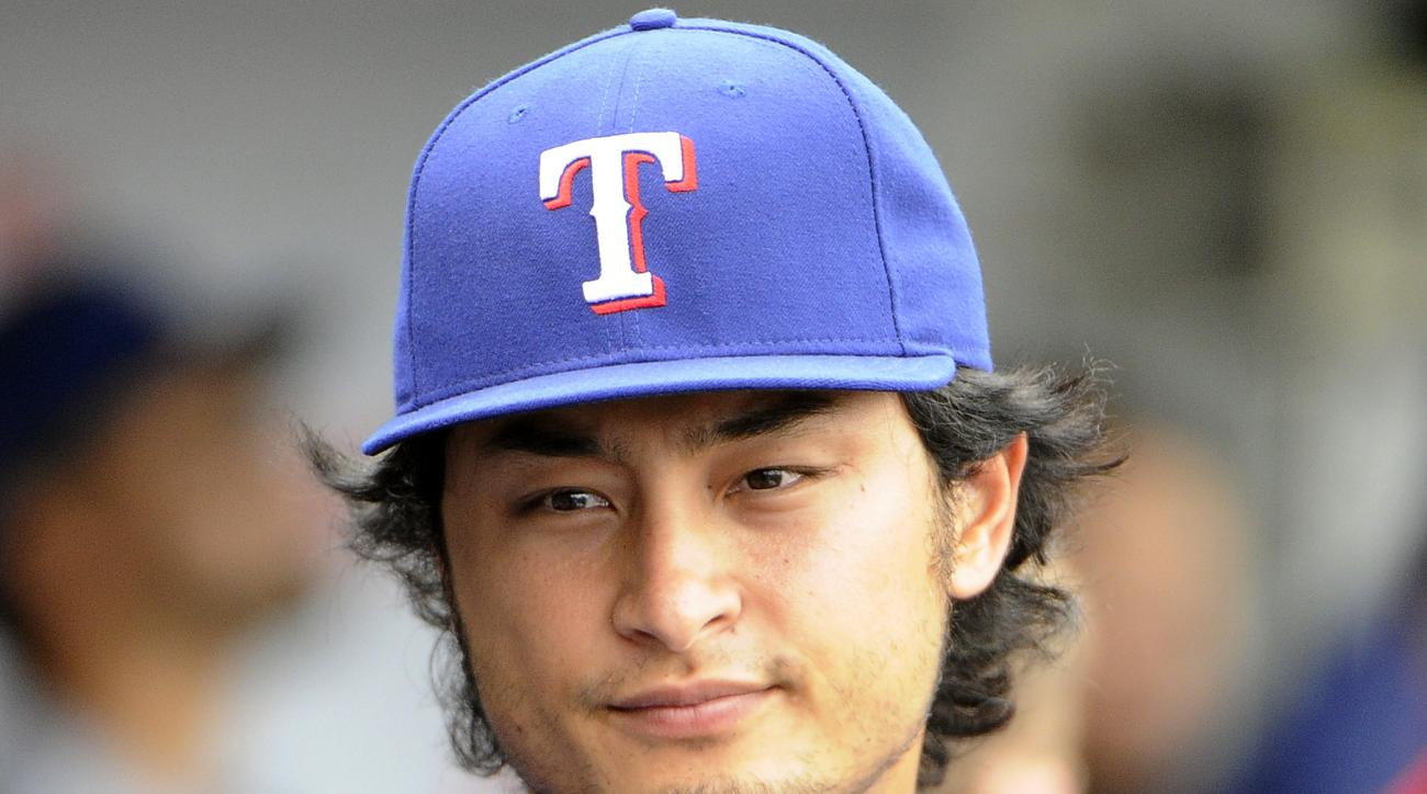 Texas Rangers pitcher Yu Darvish looks out from the dugout during the fourth inning of an interleague baseball game against the Chicago Cubs, Friday, July 15, 2016, in Chicago. (AP Photo/David Banks)