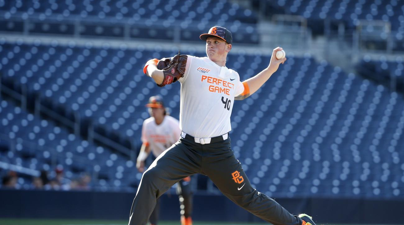 FILE - In this Aug. 16, 2015, file photo, Jason Groome pitches during the Perfect Game All-American Classic high school baseball game in San Diego. The Boston Red Sox agreed to a $3.65 million signing bonus with 17-year-old left-hander Jason Groome, the 1