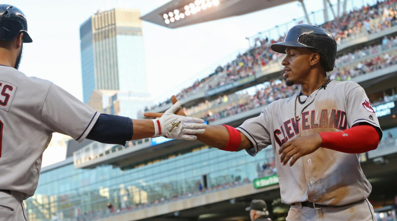 Cleveland Indians' Francisco Lindor, right, is congratulated by Yan Gomes after he scored on a single by Jose Ramirez off Minnesota Twins pitcher Ervin Santana during the fourth inning of a baseball game Friday, July 15, 2016, in Minneapolis. (AP Photo/Ji