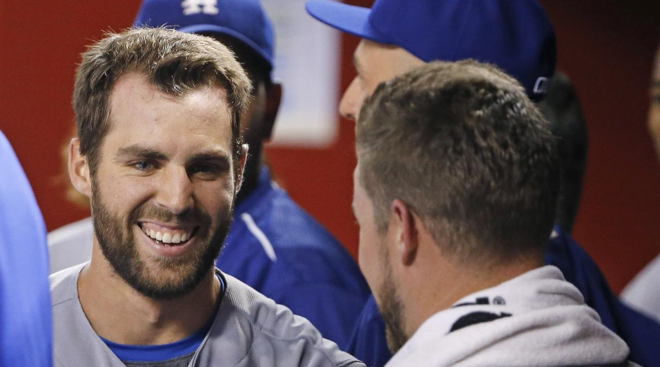 Los Angeles Dodgers' Chris Taylor, left, smiles as he celebrates his grand slam against the Arizona Diamondbacks with pitcher Bud Norris, right, during the sixth inning of a baseball game Friday, July 15, 2016, in Phoenix. (AP Photo/Ross D. Franklin)