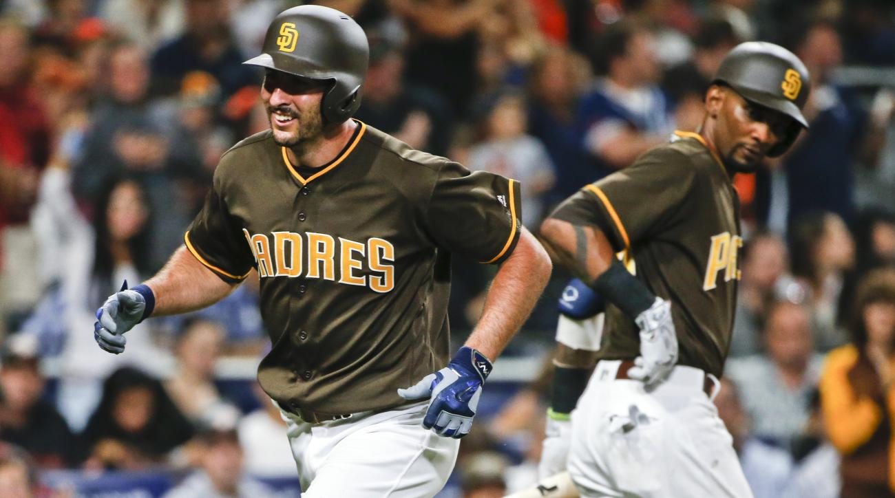 San Diego Padres' Adam Rosales is congratulated by Alexei Ramirez after hitting a home run during the fourth inning against the San Francisco Giants in a baseball game Friday, July 15, 2016, in San Diego. (AP Photo/Lenny Ignelzi)