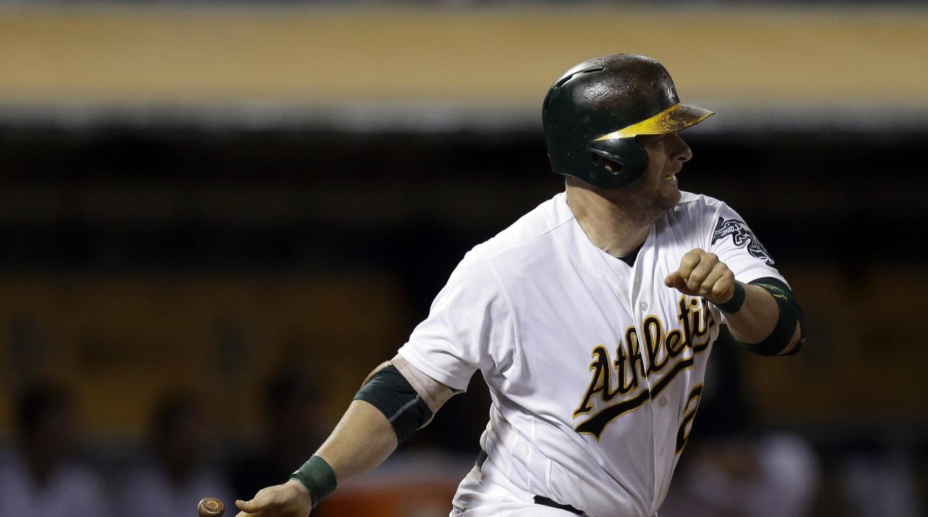 Oakland Athletics' Stephen Vogt drops his bat after hitting an RBI single against the Toronto Blue Jays during the seventh inning of a baseball game Friday, July 15, 2016, in Oakland, Calif. (AP Photo/Ben Margot)