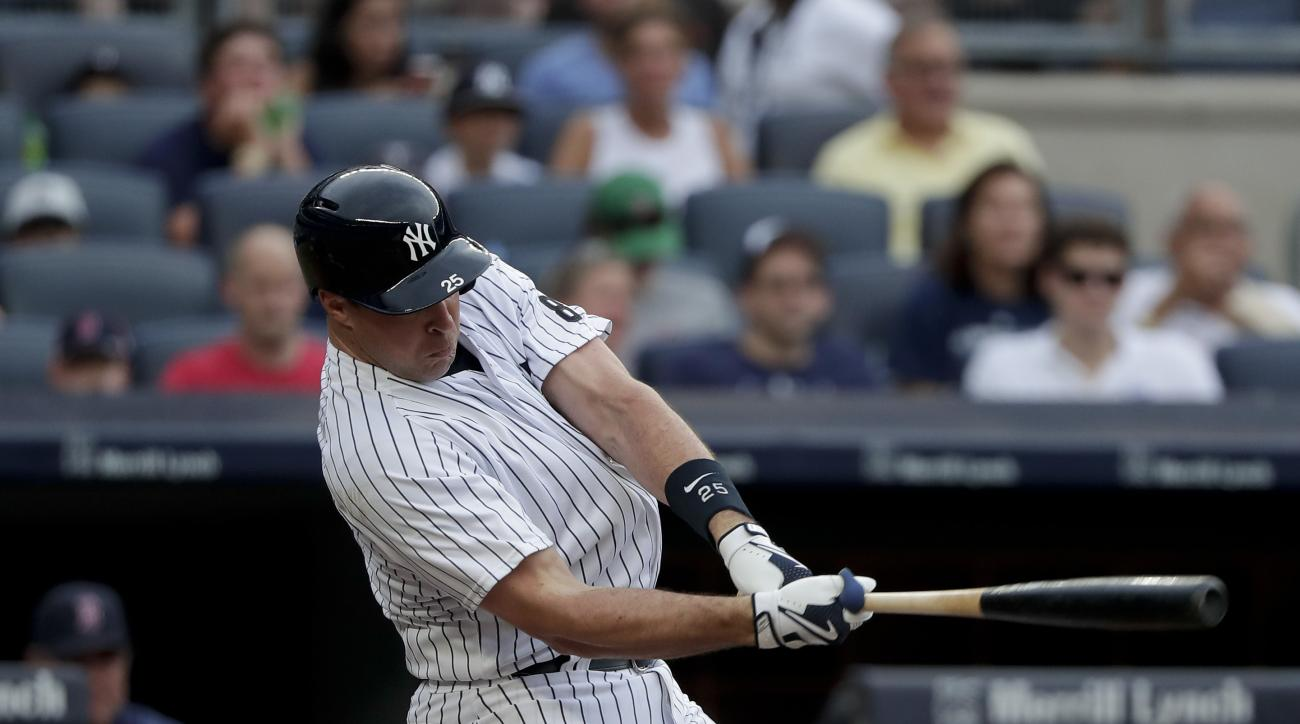 New York Yankees' Mark Teixeira fouls the ball off his ankle during the fourth inning of a baseball game against the Boston Red Sox, Saturday, July 16, 2016, in New York. (AP Photo/Julie Jacobson)
