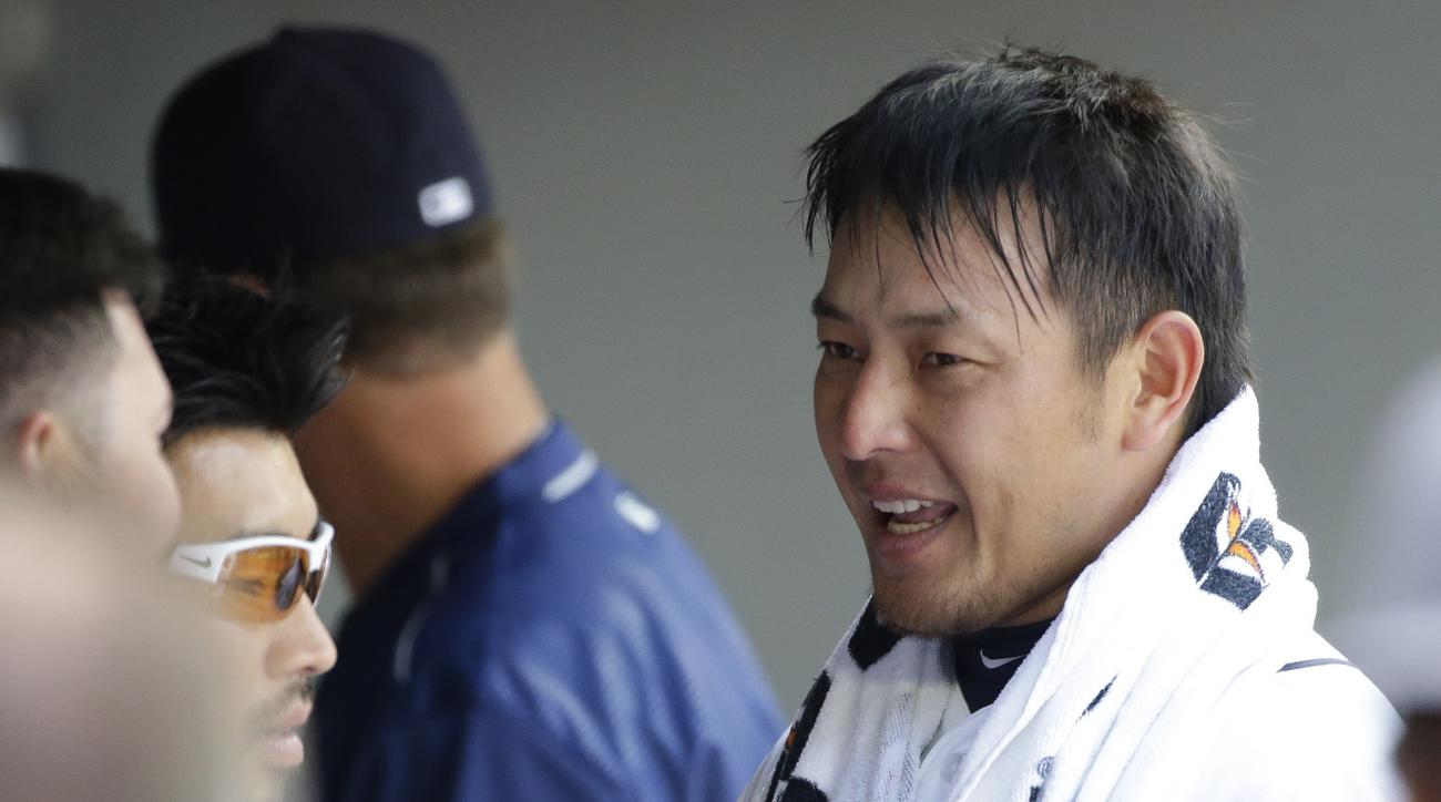 Seattle Mariners starting pitcher Hisashi Iwakuma wears a towel as he stands in the dugout after the sixth inning of the team's baseball game against the Houston Astros, Saturday, July 16, 2016, in Seattle. (AP Photo/Ted S. Warren)