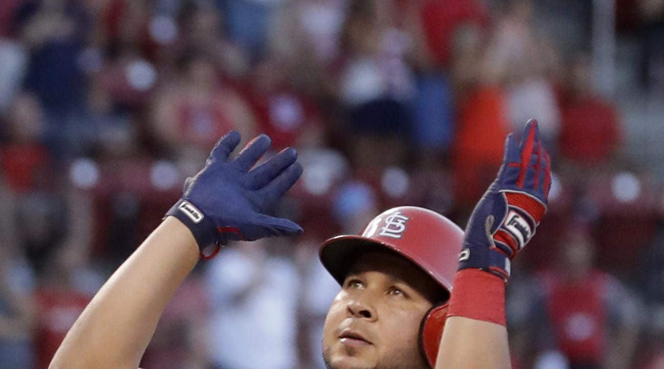 St. Louis Cardinals' Jhonny Peralta celebrates as he arrives home after hitting a solo home run during the fifth inning of a baseball game against the Miami Marlins Saturday, July 16, 2016, in St. Louis. (AP Photo/Jeff Roberson)