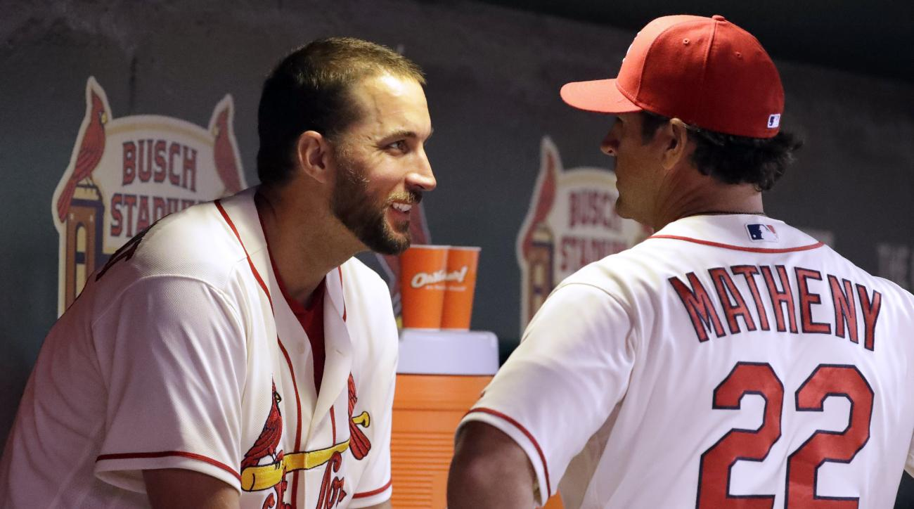 St. Louis Cardinals starting pitcher Adam Wainwright, left, talks with manager Mike Matheny during the eighth inning of a baseball game against the Miami Marlins Saturday, July 16, 2016, in St. Louis. (AP Photo/Jeff Roberson)