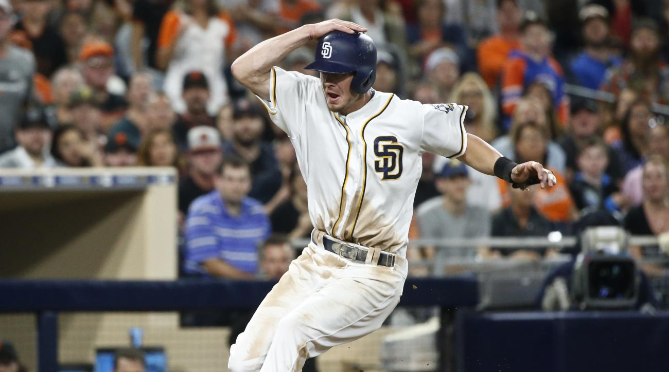 San Diego Padres' Wil Myers slows during a rundown against the San Francisco Giants in the seventh inning of a baseball game Saturday, July 16, 2016, in San Diego. Myers was called out when he left the base path. AP Photo/Lenny Ignelzi)