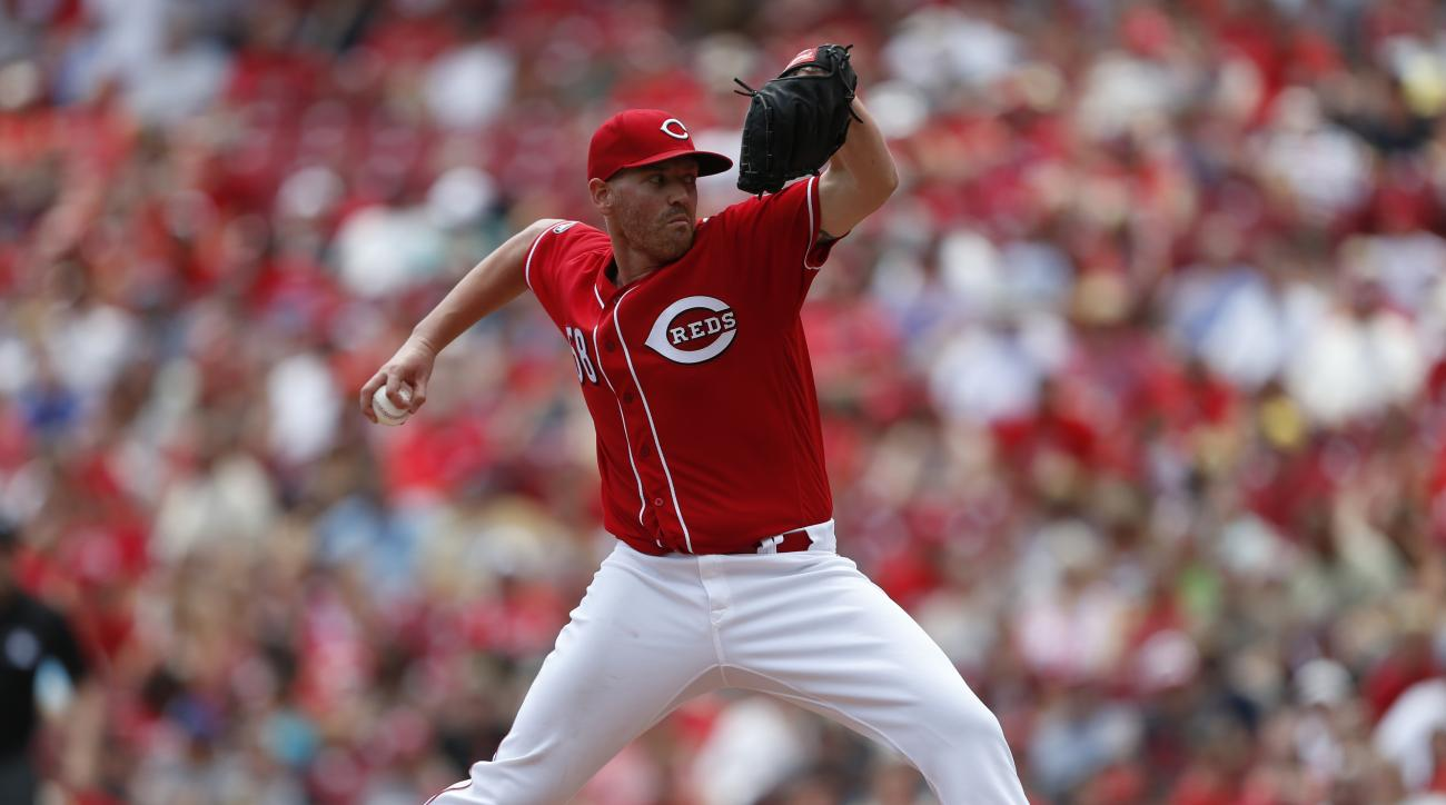 Cincinnati Reds starting pitcher Dan Straily (58) throws against the Milwaukee Brewers during the fourth inning of a baseball game, Sunday, July 17, 2016, in Cincinnati. (AP Photo/Gary Landers)