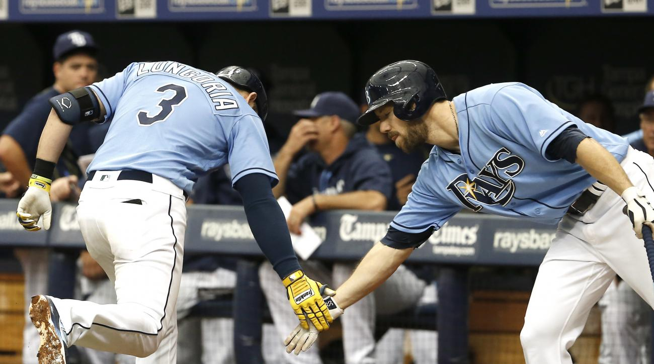 Tampa Bay Rays third baseman Evan Longoria (3) is congratulated by right fielder Steven Souza Jr. (20) after a home run during the first inning of a baseball game against the Baltimore Orioles, Sunday, July 17, 2016, in St. Petersburg, Fla. (AP Photo/Rein