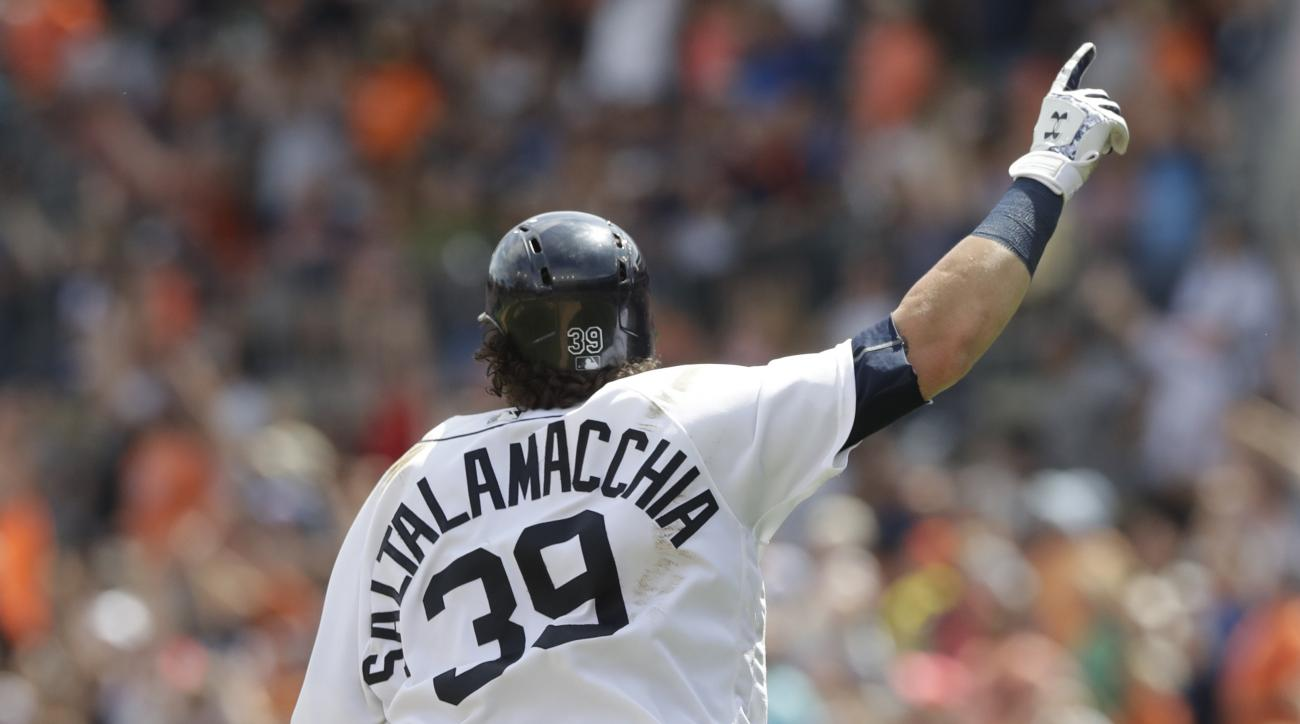 Detroit Tigers' Jarrod Saltalamacchia raises his arm after his two-run walkoff home run during the ninth inning of a baseball game against the Kansas City Royals, Sunday, July 17, 2016, in Detroit. (AP Photo/Carlos Osorio)